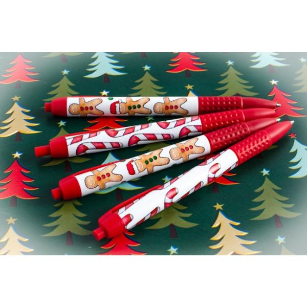Candy Cane & Ginger Bread Scented Pen on Christmas wrapping paper